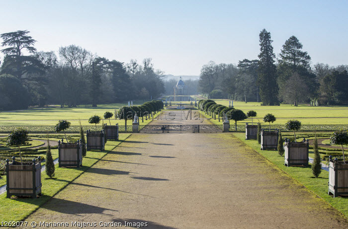 Wide path flanked with Versailles cases leading to Archer Pavilion