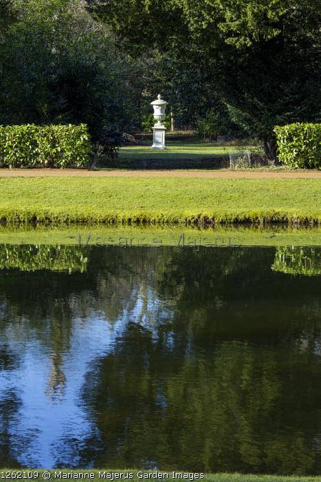 View across lake to urn on plinth
