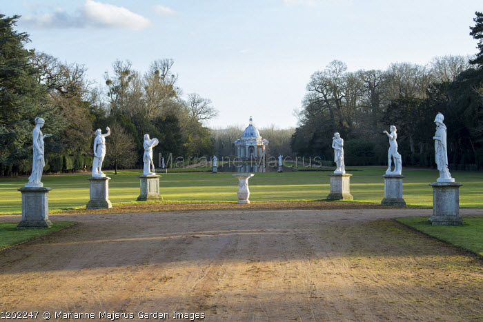 Group of classical statues on plinths, view to the Pavilion