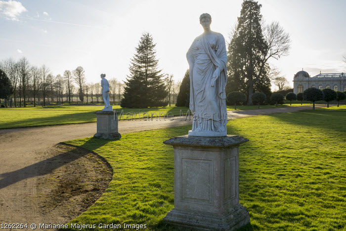 Classical statues on plinths, view to the Orangery