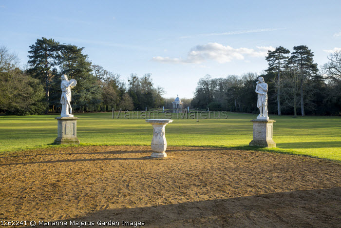 Classical statues on plinths, view to the Pavilion