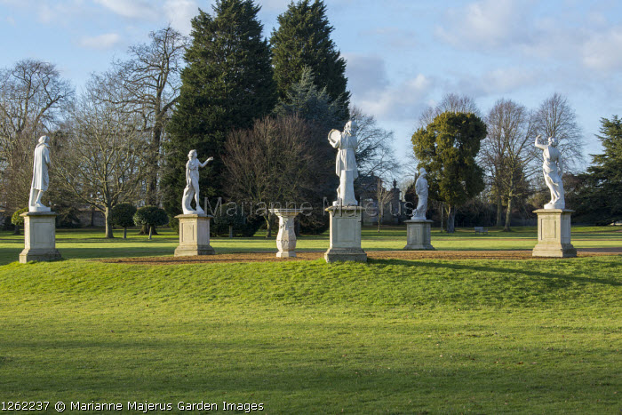 Collection of classical statues on plinths