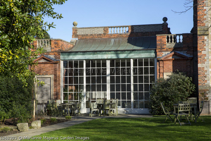 Orangery, tables and chairs on patio