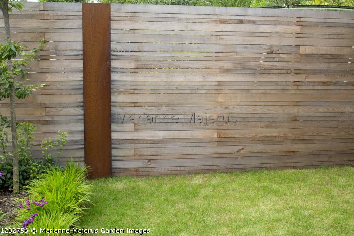 Contemporary cedar fence with Cor-Ten steel posts
