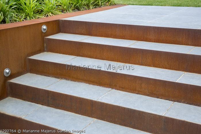 Porcelain tile steps with Cor-Ten steel risers