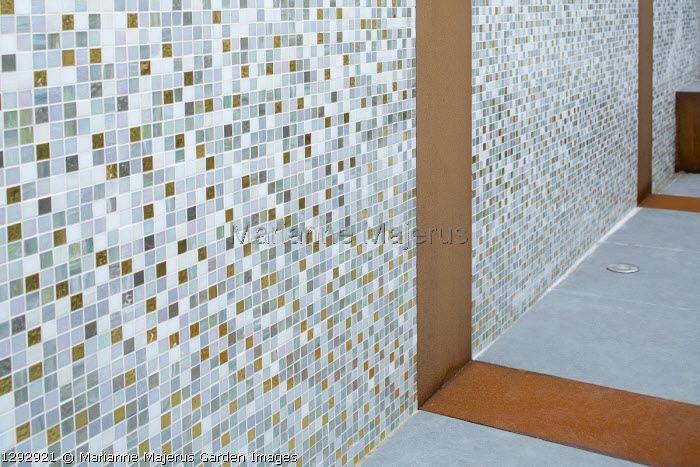 Mosaic tiled wall with Cor-Ten steel