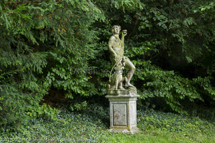 Stone statue on plinth