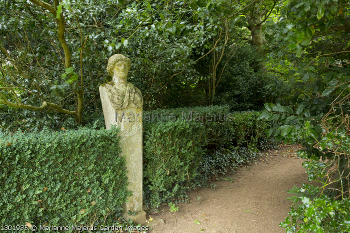 Minerva statue by woodland path