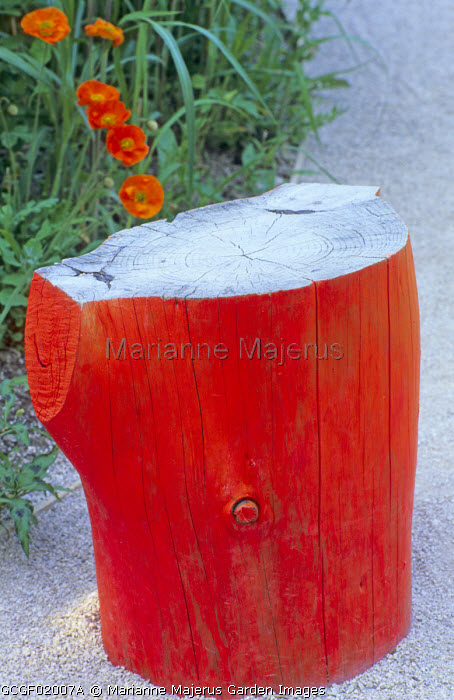 Orange painted log stool