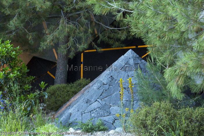 Pinus halepensis, black basalt stone pyramid, Asphodeline lutea
