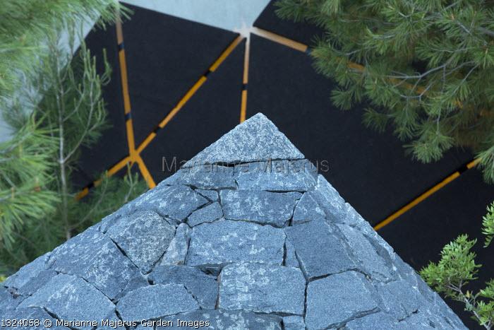Black basalt stone pyramid, Pinus halepensis, lit sculpture