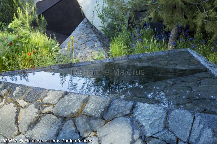 Black basalt stone raised pool and pyramid