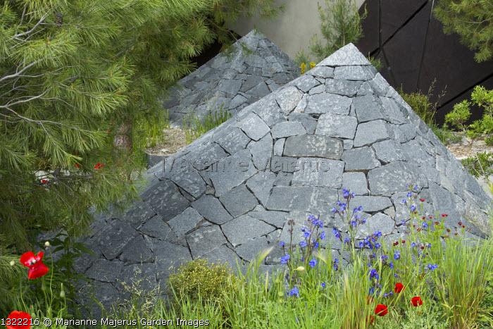 Black basalt stone pyramids, Anchusa azurea, Papaver rhoeas