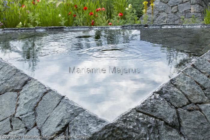Black basalt stone raised pool