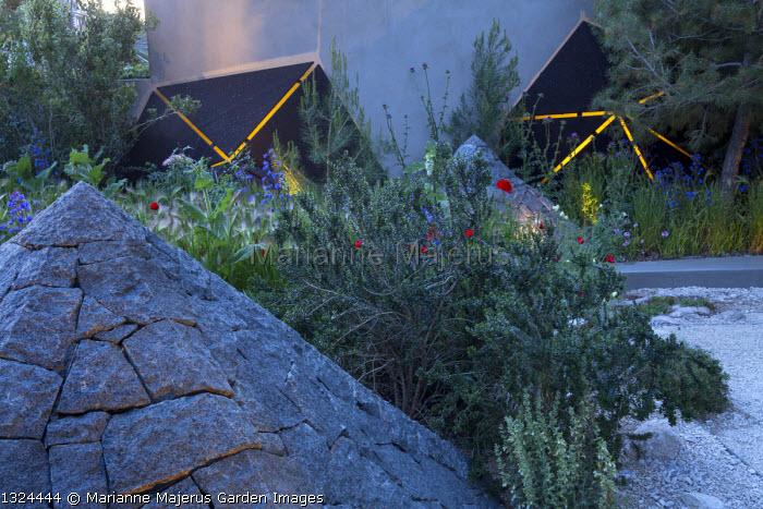Black basalt stone pyramid, lit sculptures