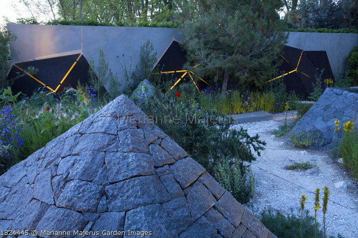 Black basalt stone pyramids, lit sculptures