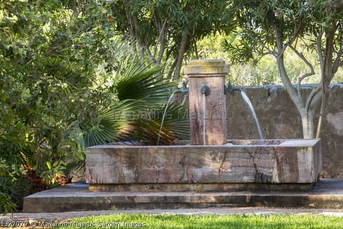 Water fountain in mediterranean garden