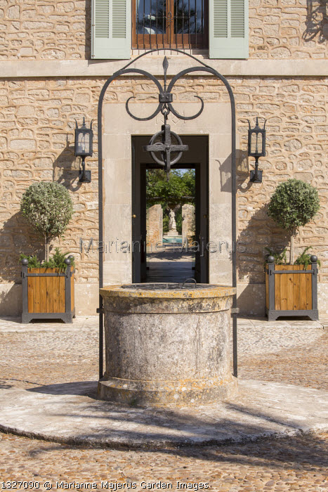 Stone well in mediterranean courtyard
