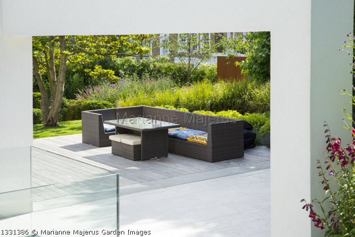 Contemporary sofa on decking under arch