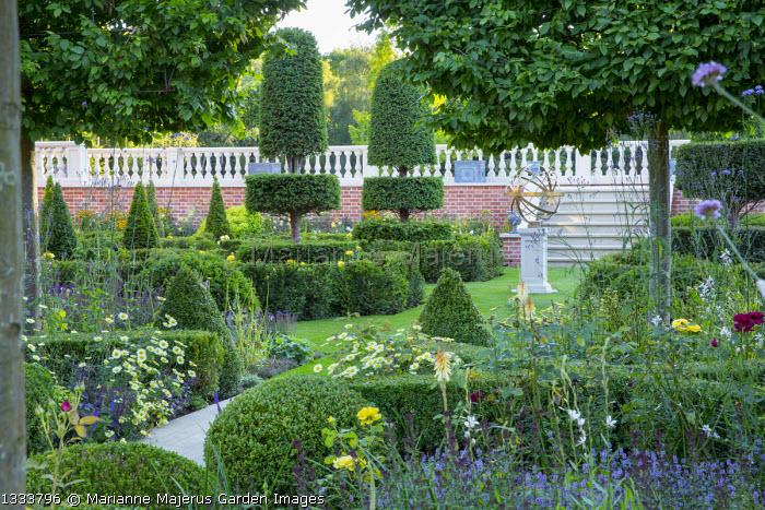 Path through formal box parterre, armillary sphere, yew topiary, Argyranthemum 'Cornish Gold'