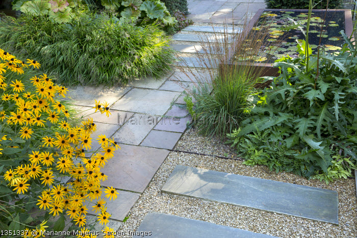 Stone patio, raised pond, Rudbeckia fulgida var. deamii, Hakonechloa macra, Molinia caerulea subsp. caerulea 'Heidebraut', Cirsium rivulare 'Atropurpureum'