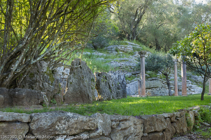 Classical stone columns, natural rocks, olive trees