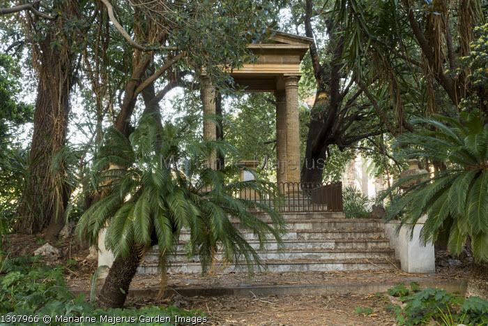 Classical stone temple in mediterranean garden