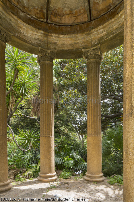 Classical stone Temple of Ceres in mediterranean garden