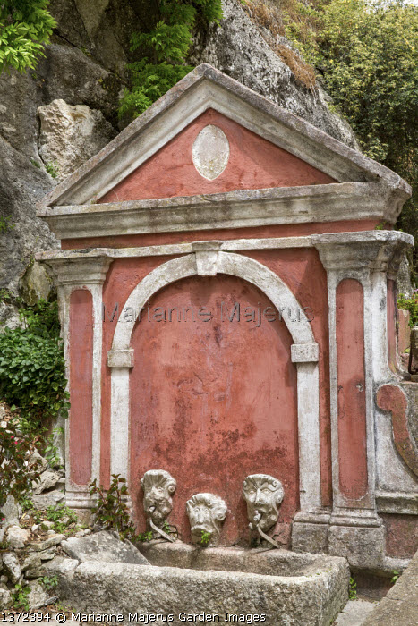 Well head, stone trough, pink painted wall