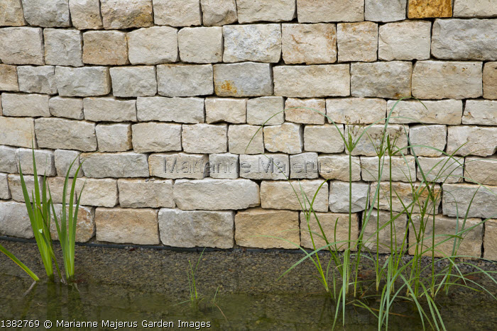 Stone wall by pond