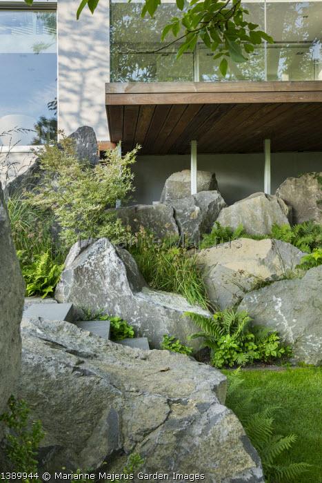 Contemporary basalt rock garden, Luzula nivea, Fragaria vesca 'Alexandria'