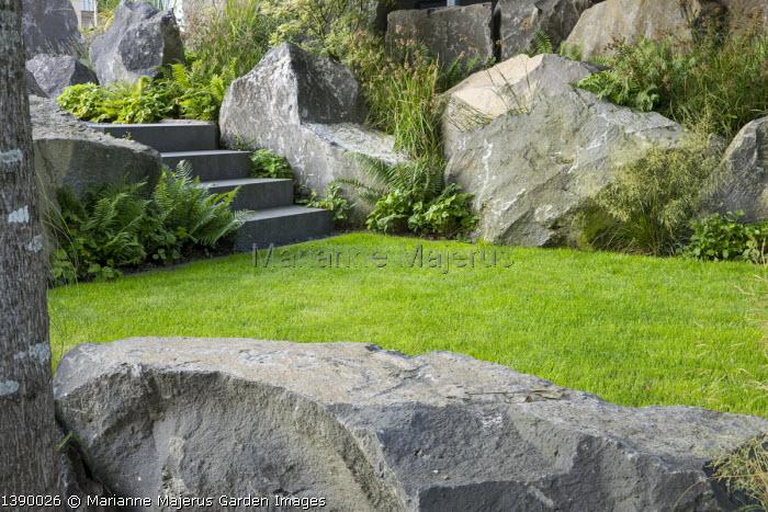 Contemporary basalt rock garden, lawn, steps, Luzula nivea, Deschampsia cespitosa