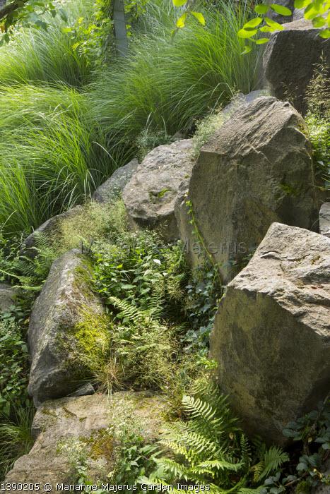 Large rocks in sloping rockery, large basalt rocks