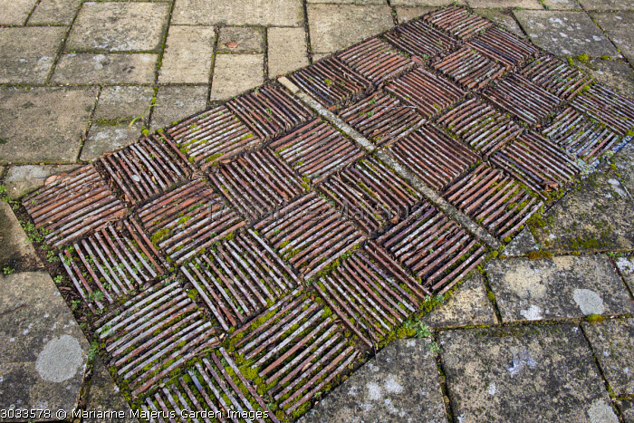 Upended tile and stone paving