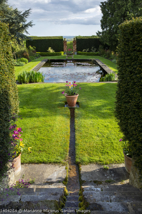 Formal rectangular pond in yew hedge enclosure, garden 'room', rill cascade