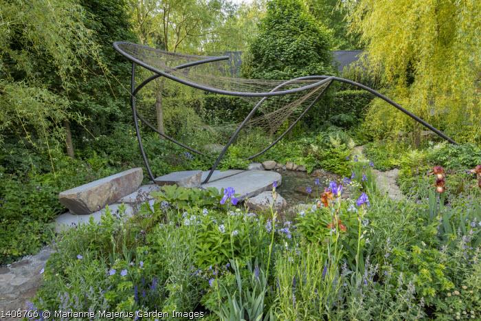 Contemporary pavilion over stream and stone terrace, Iris 'Kent Pride', Aruncus 'Guinea Fowl', Osmunda regalis, Geranium pratense 'Mrs Kendall Clark', Amsonia illustris, Geum rivale