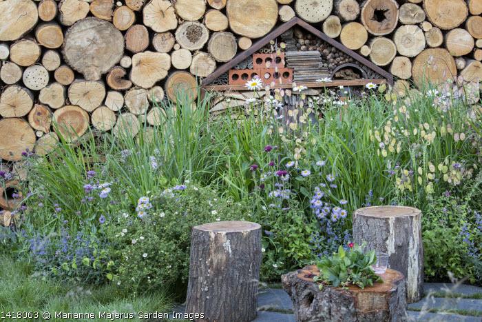 Cut log stools on patio, log wall, insect 'hotel', wildlife habitat