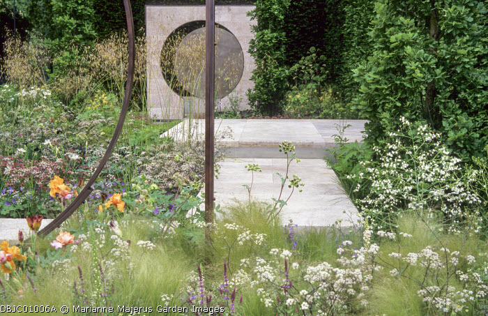 Matrix planting, Travertine marble patio, Stipa gigantea, irises, Stipa tenuissima, Anthriscus sylvestris 'Ravenswing'