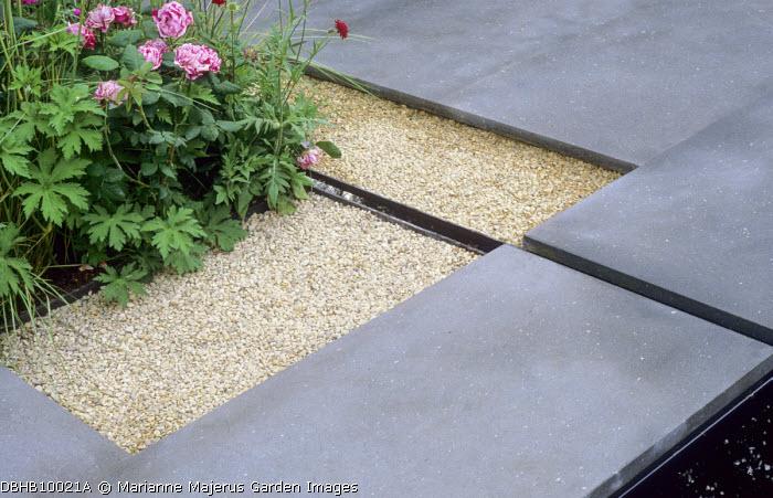 Geometric paving design, basalt paving, rill, gravel, roses