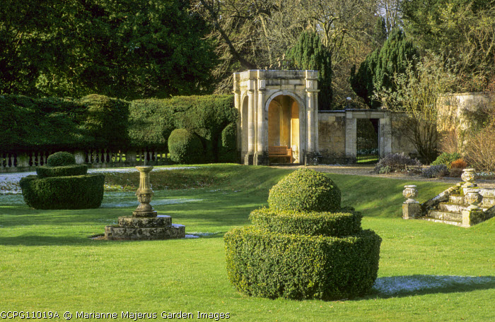 View to stone temple, yew topiary, sundial