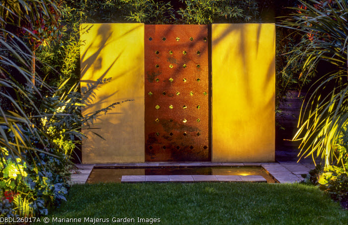 Rectangular pond with slate edging, water wall with rust panel, lighting, shadows