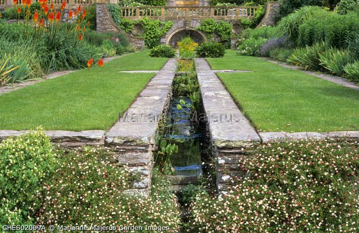 Formal rill garden, Erigeron karvinskianus in stone wall cracks