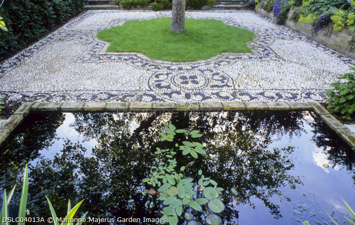 Rectangular pond, pebble mosaic by Michael Gough, apple tree in lawn, Aponogeton distachyos, Water hawthorn