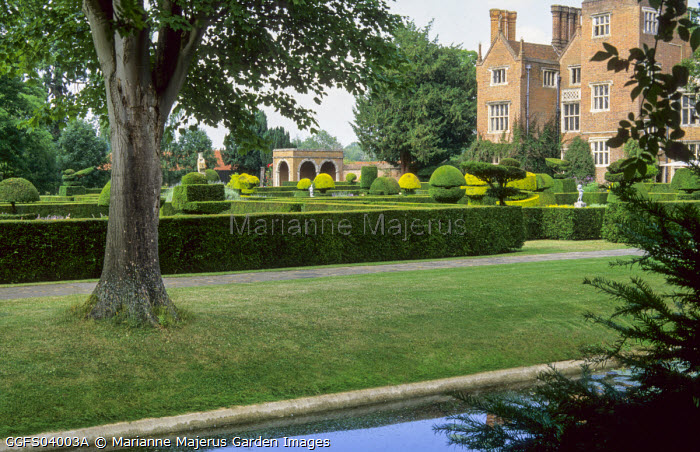 View across moat to house, topiary garden