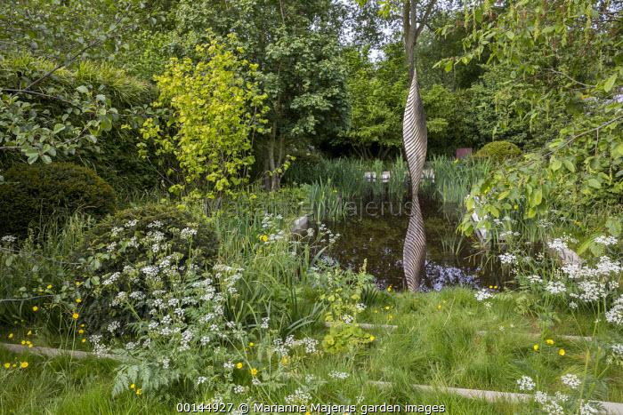 Bronze sculpture, Nyneve, reflected in formal pool, clipped yew domes, Anthriscus sylvestris, Ranunculus acris, Corylus avellana 'Aurea', Iris pseudacorus, Tellima grandiflora