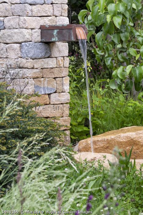 Water shute fountain, stone wall