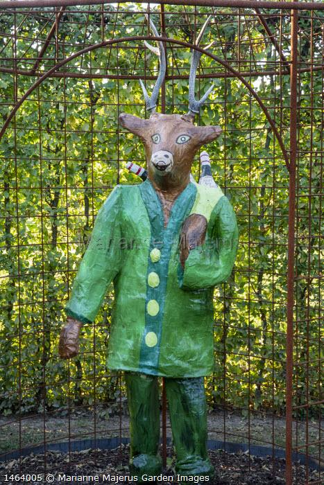Contemporary painted papier-mâché deer figure in metal arbour