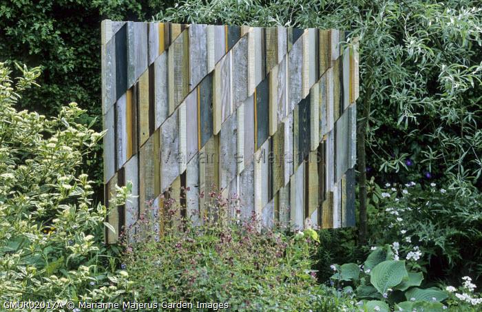 Pyrus salicifolia 'Pendula', Geranium phaeum, woodwork panel by Margaret Murton