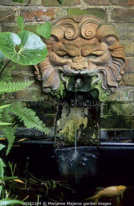 Terracotta mask wall fountain, fish pond