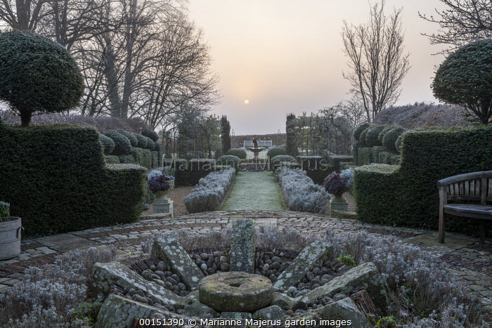 Formal topiary and hedges, large clipped Buxus sempervirens domes, lavender hedges, garden 'room'